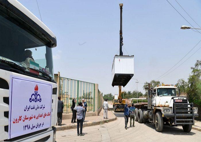 تحویل و استقرار بخشی از تجهیزات اهدایی شرکت ملی نفت ایران به سیلزدگان